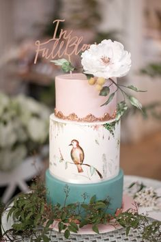 bird-themed cakes - photo by LoveHer Photography http://ruffledblog.com/botanical-baby-shower-with-rose-gold
