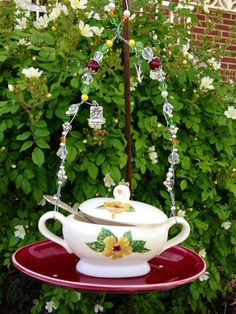 """Sold... """"Vintage Sugar Bowl""""  Special order using all vintage dishes made in Calif on the bird feeder ...all my feeders come with gift card and small bag of organic bird seed....  Kelly Parker Cassiere ... Facebook"""