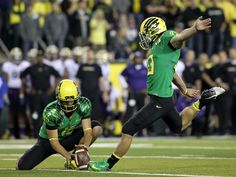 Oct. 6 vs. Washington: The Ducks wore Apple Green jerseys and yellow helmets for the second time in 2012, but for the first time with black pants. #GoDucks (Eric Evans photo)