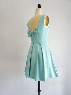 January Dress in Seafoam -  A sleek fit &flare skater dress in stretch ponte knit Tried and true, customer favorite fabric for the ultimate flattering fit Full pleated skirt with hidden side pockets Deep back scoop neckline with darling bow accent A dress for all occasions : bridesmaids, weddings, events and parties   DETAILS  Fit : True to size. Fitted at bust and waist. Size...