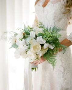 Lily carried a burst of garden roses, white cyclamen, ferns, and wild grass  Productions.