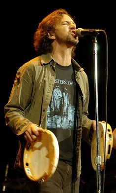 EV: 1) I love his shirt. 2) I'm gonna GET one of those tambourines one day! I have a plan. My BFF's son is gonna help me. I just have to bring him to a Pearl Jam concert when he's old enough! :)