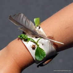 Nature Bracelet with Masking Tape - just this simple outdoor activity for children. Turn a strip of masking tape inside out and adhere to wrist. Double over for extra width. Encourage kids to go out + explore the garden, adding their treasure hunt disc