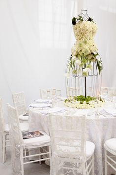 Wedding dress centerpiece tablescape in white, green and red for the Red Cross Ball by The White Dress by the Shore, Jubilee Events and Datura: A Modern Garden