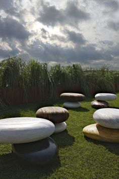 Marble and Wood outdoor seating by Kreo. I would live on these...