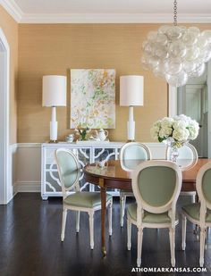 Olly Studio Bubble Chandelier, Phillip Jefferies grass cloth wall covering, Michelle Armas painting, pastel green vinyl dining chairs,