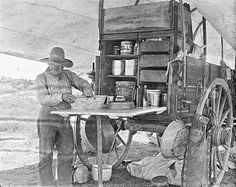 This is a cook named Sam Whittaker preparing something on a chuck wagon at the LS Ranch near Tascosa, 1907. At this point in time the LS ranch covered 221,000 acres.   Famous cowboy photographer Erwin Smith took this and it comes courtesy the Amon Carter Museum in Fort Worth. via Traces of Texas FB (making biscuits?)