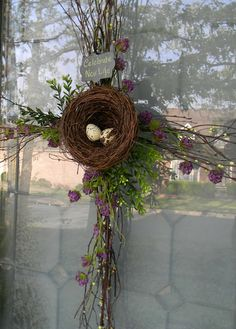 Easter Door Decor | southern fried gal - I found my inspiration hanging on a door at a local boutique a few days ago. It was a sprig of blooming twigs tied with a burlap bow and a bird's nest. Simple and sweet.