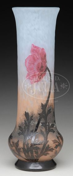 """DAUM PADDED AND WHEEL CARVED CAMEO VASE. Daum vase has brown acid cut cameo leaves and stems climbing the neck of the vase and leading to three padded and wheel carved poppies all set against a mottled brown shading to mottled white background which has a light martele pattern. Vase is signed on the side with engraved signature """"Daum Nancy"""" with the Cross of Lorraine."""