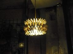Clothes pin chandelier - there must be a million ways to arrange those pins to a great looking chandelier.