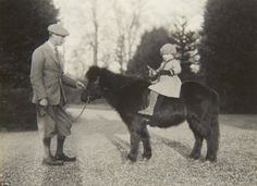 Horsewoman from the start: Elizabeth in 1930, posing with her father on her Shetland pony, Peggy, a fourth birthday present from her grandfather George V