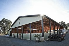 This custom all wood equestrian facility is located in Shingle Springs, CA. It has a 60'x120' covered riding arena and a 24'x120' stable with 6 custom horse stalls, wash rack, tack room, and plenty of room for storage. Built by DC Building