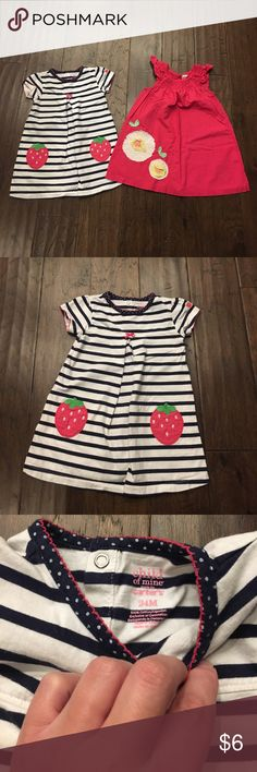 Set of Two Girls Dresses (2T-24 months) Set of two girls dresses.  1-Navy and white striped dress with strawberry accents.  Size 24 months.  2-Hot pink Cherokee dress with floral accent.  Size 2T.  Please make me an offer and don't forget about my bundle discount! Dresses Casual