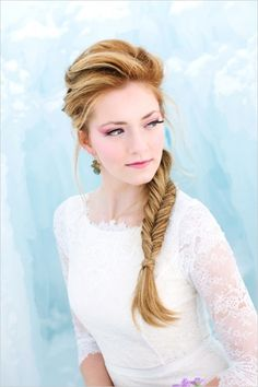 Disney's Frozen themed wedding hair #weddinghair #frozen #weddingchicks http://www.weddingchicks.com/2014/04/03/frozen-wedding-ideas/
