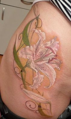 nice tattoo...I wouldn't want a lily, but I like that it's not outlined in black...would want a tattoo in white, like this