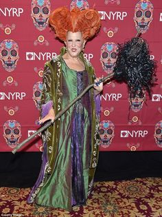 Seems like old times: On Friday night, Bette Midler dressed as her Hocus Pocus character Winnie Sanderson for the 'Hulaween' masquerade ball in New York City