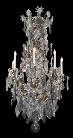 19th c. Baccarat crystal and bronze chandelier with candles.