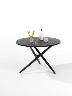 Jürg Bally, Daniel Hunziker Table top covered with linoleum and solid wood edge, diameter frame in solid wood adjustable Central foot connection in cast iron, anthracite, adjustment mechanism of stainless steel. Table Top Covers, Adjustable Height Table, Cast Iron, Solid Wood, Connection, Stainless Steel, Frame, Furniture, Home Decor