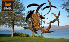 Kinetic feather wind spinner