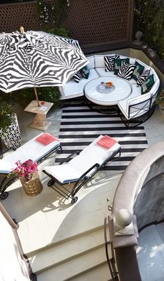 Take cover from the sun and relax under the exotic canopy of our Scalamandre Zebra Skin Onyx Umbrella.  | Frontgate: Live Beautifully Outdoors