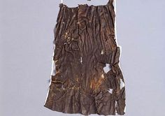 Ötzi's loincloth, a rectangular piece of 33 cm-wide goatskin leather. It was fashioned from long narrow strips cross-stitched together with twisted animal sinews.  The remains of the loincloth show that it was originally around one metre in length. It was pulled between the legs and fastened at the waist with a belt.