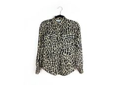"""90's Silk Leopard Print Minimal Button Up Blouse, Vintage 90's sheer button up top 100% silk. Super flowy, oversize by Elenore Brenner.  Perfect vintage condition, covered buttons, two front pockets, buttons on sleeves.    Size M    BUST: 38""""  LENGTH: 26""""  SLEEVES: 24""""  SHOULDERS: 18"""" by FeelingVagueVintage, $32.00"""