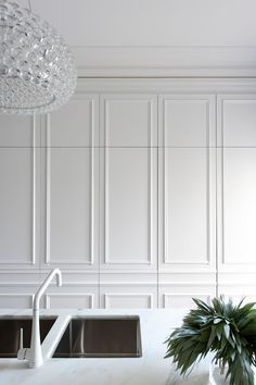 Parisian styled wall panelling painted brilliant white and a modern take on the traditional herringbone timber floor were the main French influences. To create a modern twist, longer sections of timber were used and a dark chocolate stain with matt polyurethane coating finished the boards. A great foundation for the kitchen when insitu.