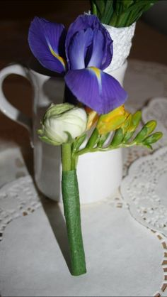 Buttonhole - Iris, freesia and ranunculus.