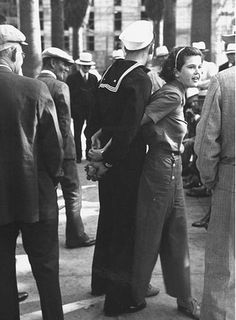 U.S. A sailor and his gal, 1937 // Photo by Peter Stackpole late 30s war era casual vintage fashion style street found pants girl button trouser shirt blouse hair