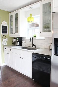 Ikea kitchen with glass front cabinets and subway tile back splash.  This would be perfect for our kitchen ... Simple clean and looks good even though its small.
