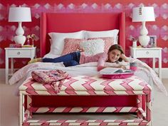 "Kate, 12, loves cheerleading—her peppy spirit inspired her fuchsia bedroom. At the end of the upholstered bed is a bench from Lee Industries. ""She's into fashion, and that's where she lays out clothes and jewelry combos,"" Stacey says."