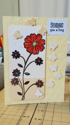 Honeycomb embossing folder by Kaisercraft on the cardstock, stamped paintchips and punch cut butterflies.