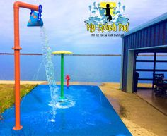 Stunning backdrop to this Texas splash pad that we installed.  Right on the edge of the lake. # above ground water play features, 12 below ground nozzles on our exclusive platform surface and MSP Safer Surface for a fun, safe and color splash pad.