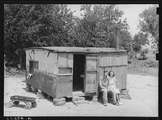 "Shack""-Actual title ""WPA (Works Progress/Work Projects Administration) worker and his wife sitting in front of their shack home on the Arkansas River near Webbers Falls, Oklahoma. This man said that last year he thought maybe he would be a little better off when he got the WPA work and had a small amount of cash coming in, but that he was worse off now. 'Last year I had a cow and some chickens and I had to sell my cow and eat my chickens. I get worse off every year'"" (Russell Lee, 1939)"
