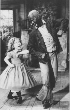 "Bill ""Bojangles"" Robinson, vaudeville and musical stage star, was 56 years old when he appeared with 6 year old Shirley Temple in two 1935 films, The Little Colonel and The Littlest Rebel.  They were the first interracial dance partners to appear together on film."