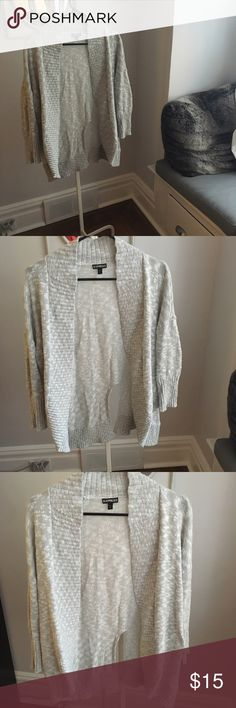 Gray Marled Split Back Open Cardigan Awesome gray marled open cardigan. Trendy split back makes this sweater perfect for layering over a flowy top for a peekaboo effect. Excellent used condition. Express Sweaters Cardigans
