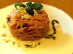 Tagliatelle al pomodoro fresco e letto di burrata con emulsione al basilico