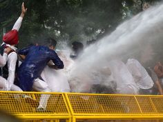 Delhi police use a water cannon to disperse activists of the Indian Youth Congress standing on a police barricade and shouting slogans against the Narendra Modi-led National Democratic Alliance (NDA) government during a protest against intolerence in New Delhi.  Prakash Singh, AFP/Getty Images