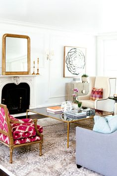 White walls, feather art and mirror over fireplace, love the missoni pillows