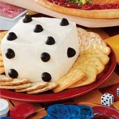 Cheese Spread Dice...You'll shake up your buffet table in an appetizing way with this delectable cracker spread. The novel cube of seasoned cream cheese is easily spotted with ripe olives.