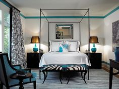 black & teal bedroom with zebra footstools - for a friend who would love this in in pink!