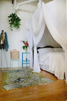 "Sneak Peek: Jon & Nina Hans. ""Our canopy bed is a blast. Since our loft is so open, it gives a little sense of privacy when we have guests spending the night. Jon put it up one day while I was at work, so when I came home that day I freaked! I love it! The rug was a wedding present from Anthropologie, from my sister-in-law."" #sneakpeek"