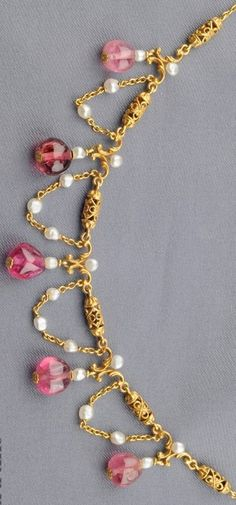 Art Nouveau Pink Tourmaline and Seed Pearl Fringe Necklace, designed as pierced cylinders suspending tourmaline beads, spaced by seed pearl swags, and completed by trace links, 14kt gold mount. #ArtNouveau #necklace