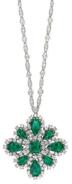 An Important Colombian Emerald and Diamond Brooch/Pendant Necklace.  The detachable pendant designed as a circular-cut diamond and vari-cut Colombian emerald plaque, suspended from a sautoir designed as a series of navette-shaped links enhanced by bead-set diamonds, interspersed with collet-set diamonds, mounted in 18K white and yellow gold, necklace length 27 1/2 inches, pendant length 2 inches. Via Phillips.