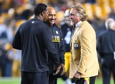 NFL Hall of Famer Kevin Greene chats with Pittsburgh Steeler coaches Carnell Lake and Joey Porter during warmups before the game against the Kansas City Chiefs at Heinz Field on Oct. 2, 2016 in Pittsburgh.