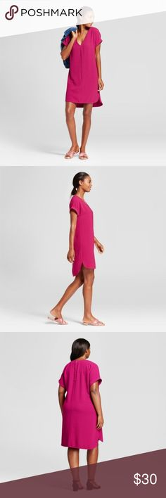NEW A New Day Magenta Short-Sleeve Crepe Dress C5 For a look you can sport during the day or at night, reach for the Short-Sleeve Crepe Dress from A New Day. It comes in a simple design to add effortless radiance to your everyday style. You'll love the easy comfort of the relaxed fit & curved high-low hem — whether you keep things casual for a shopping date by wearing sneakers and a denim jacket or go a bit dressy for a night out wearing strappy heels, you'll look great and feel even better…