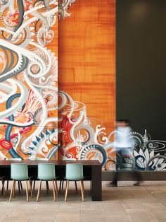 In the Key Center lobby, SKB artist/muralist Jonathan Wakuda Fischer spray-painted a mural on existing maple paneling. Photography by Spencer Lowell.
