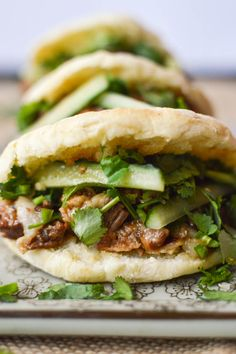 These Rou Jia Mo sandwiches are sometimes called a Chinese hamburger. They're made using a versatile flatbread recipe and a braised pork belly filly. Don't forget cilantro and chilies! #chineserecipes