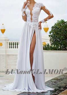 Gorgeous sexy slit wedding dress made by french lace, lace appliques and chiffon. The dress features with deep open back and v neckline with bra
