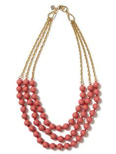 coral color triple-strand necklace
